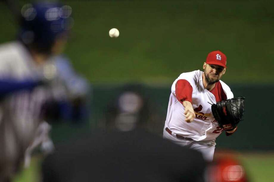 ST LOUIS, MO - OCTOBER 28:  Chris Carpenter #29 of the St. Louis Cardinals pitches in the first inning during Game Seven of the MLB World Series against the Texas Rangers at Busch Stadium on October 28, 2011 in St Louis, Missouri. Photo: Ezra Shaw, Getty / 2011 Getty Images