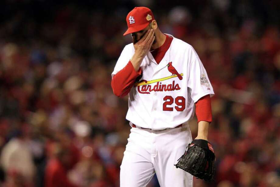 ST LOUIS, MO - OCTOBER 28:  Chris Carpenter #29 of the St. Louis Cardinals reacts on the mound in the first inning during Game Seven of the MLB World Series against the Texas Rangers at Busch Stadium on October 28, 2011 in St Louis, Missouri. Photo: Jamie Squire, Getty / 2011 Getty Images
