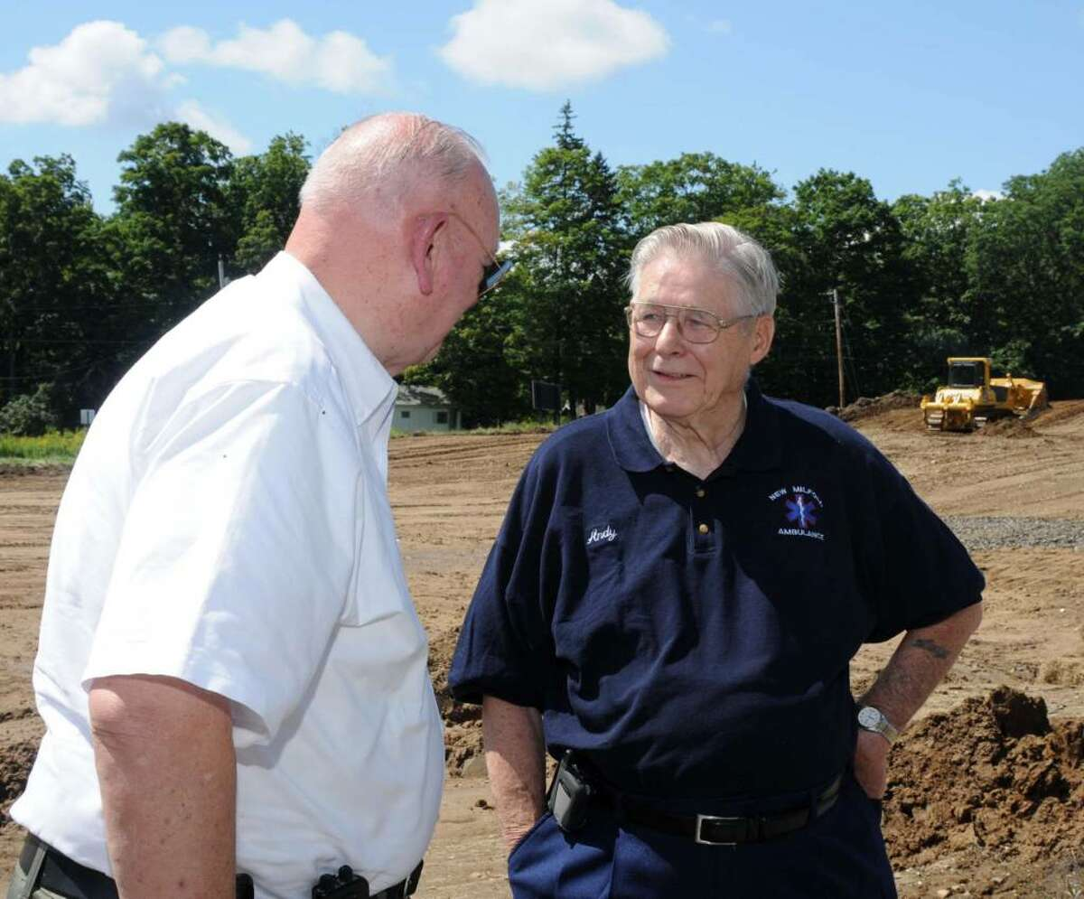 Lisa Weir - Photographer The groundbreaking ceremony for the New Milford Community Ambulance Corporations new ambulance barn took place on Friday at the new site. George Buckbee, left, talks with Andy Armstrong, President of the New Milford Community Ambulance Corp. before the ceremony begins. August 14, 2009