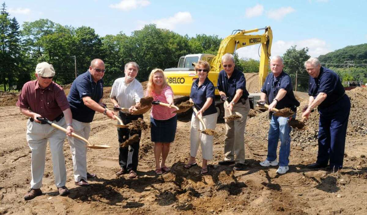 Lisa Weir - Photographer The groundbreaking ceremony for the New Milford Community Ambulance Corporations new ambulance barn took place on Friday at the new site. From left, Ray O'Brien, Tom Bock, Roger Szendy, Mayor Pat Murphy, Donna Hespe, Jack Oxton, Bob Dumas and Andy Armstrong, the President of The Community Ambulance Corp.. (All from New MIlford) August 14, 2009