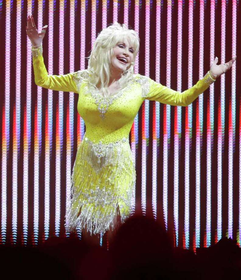 Confirmed: Dolly Parton is a proud performer and wig wearer.  Photo: Melissa Phillip / © 2011 Houston Chronicle