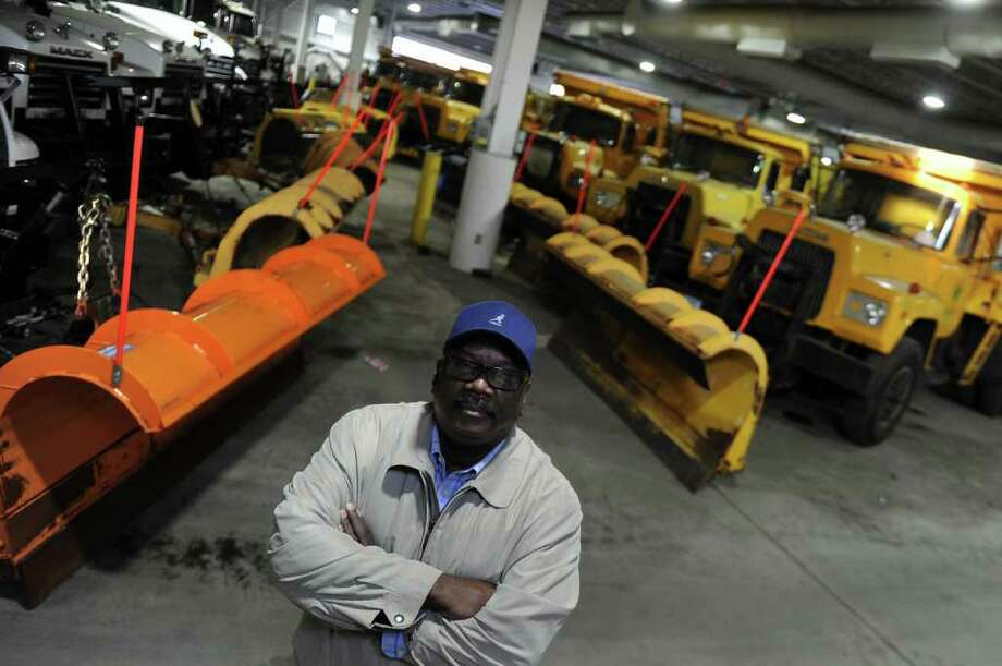 Robert Kennedy, Deputy Director of Public Facilities, stands in front of the city's fleet of snow plows which are ready for Saturday's expected snowstorm in Bridgeport, Conn. on Friday October 28, 2011. Photo: Christian Abraham / Connecticut Post