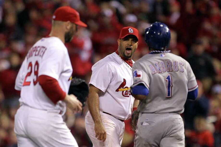 ST LOUIS, MO - OCTOBER 28: Albert Pujols #5 of the St. Louis Cardinals reacts after Elvis Andrus #1 of the Texas Rangers grounds out to pitcher Chris Carpenter #29 to end the top of the second inning during Game Seven of the MLB World Series at Busch Stadium on October 28, 2011 in St Louis, Missouri. Photo: Ezra Shaw, Getty / 2011 Getty Images
