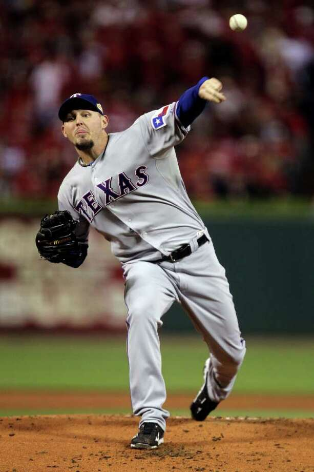 ST LOUIS, MO - OCTOBER 28:  Matt Harrison #54 of the Texas Rangers pitches in the second inning during Game Seven of the MLB World Series against the St. Louis Cardinals at Busch Stadium on October 28, 2011 in St Louis, Missouri. Photo: Ezra Shaw, Getty / 2011 Getty Images