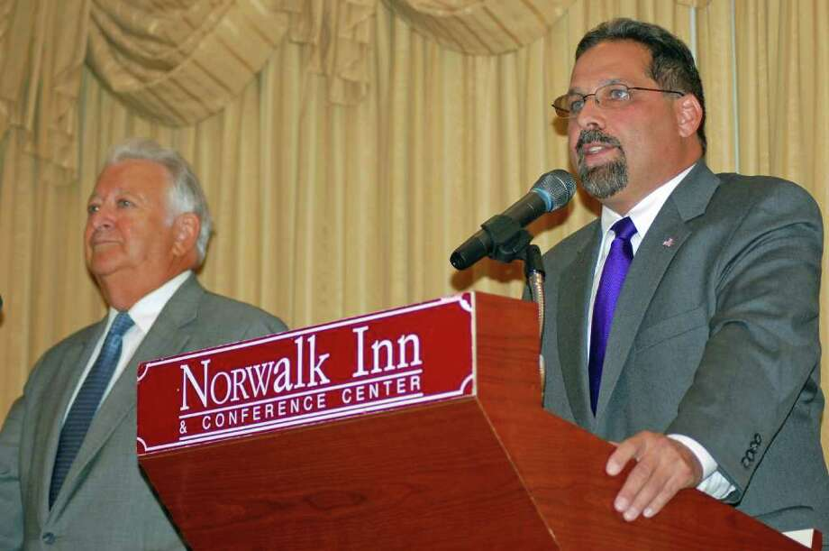 Democratic mayoral candidate, Andy Garfunkel, Norwalk's town clerk, answers a question while incumbent Richard Moccia waits his turn for a rebuttal at a debate hosted by the Norwalk Chamber of Commerce at the Norwalk Inn on Thursday. Photo: Nicole Rivard/Staff Photographer