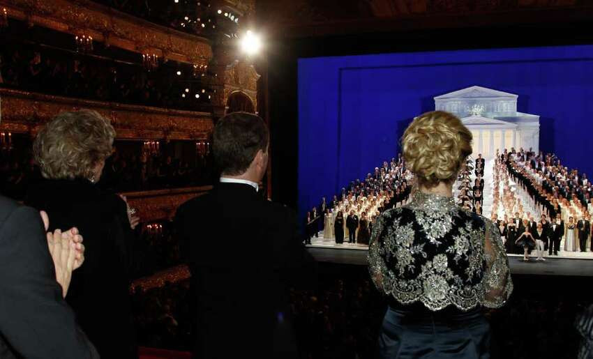 Russian President Dmitry Medvedev, center, his wife Svetlana, right, and famous opera singer Yelena Obraztsova, left, attend a gala opening of the Bolshoi Theater in Moscow, Friday, Oct. 28, 2011.