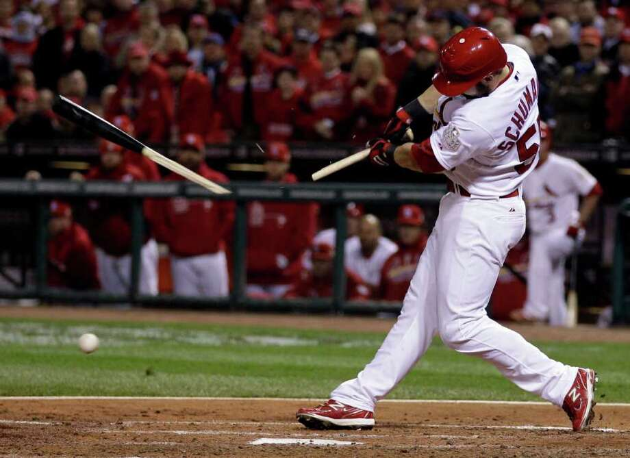 St. Louis Cardinals' Skip Schumaker breaks his bat as he grounds out during the fourth inning of Game 7 of baseball's World Series against the Texas Rangers Friday, Oct. 28, 2011, in St. Louis. (AP Photo/Matt Slocum) Photo: Matt Slocum, Associated Press / AP