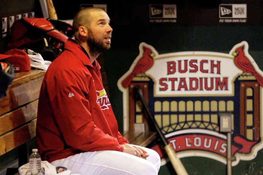 ST LOUIS, MO - OCTOBER 28:  Chris Carpenter #29 of the St. Louis Cardinals sits in the dugout during Game Seven of the MLB World Series against the Texas Rangers at Busch Stadium on October 28, 2011 in St Louis, Missouri. Photo: Jamie Squire, Getty / 2011 Getty Images