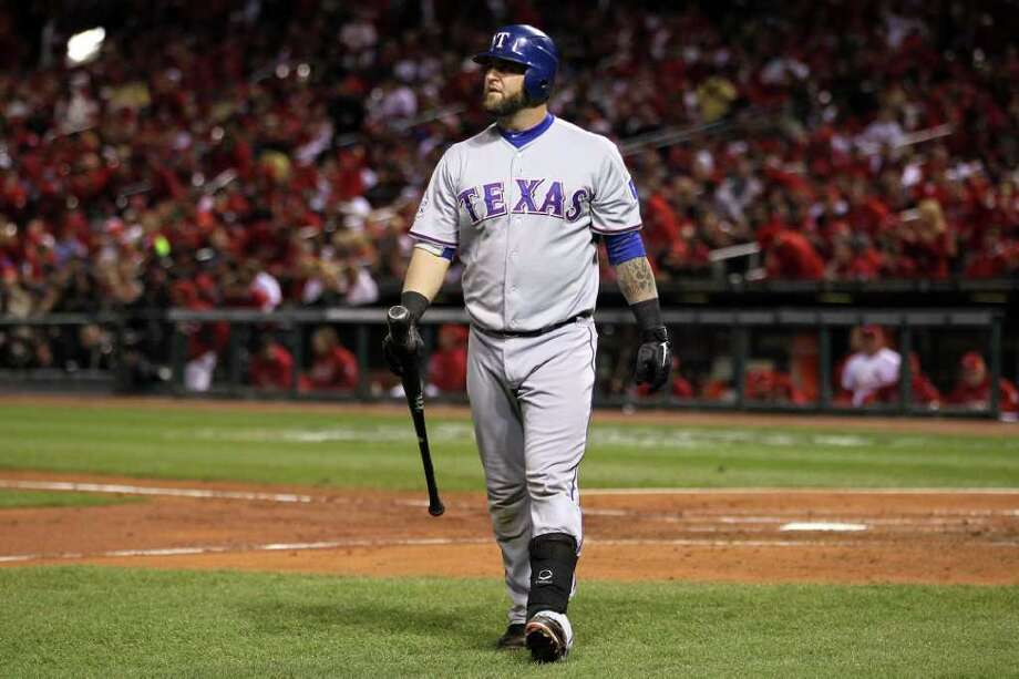 ST LOUIS, MO - OCTOBER 28:  Mike Napoli #25 of the Texas Rangers reacts after striking out in the fourth inning during Game Seven of the MLB World Series against the St. Louis Cardinals at Busch Stadium on October 28, 2011 in St Louis, Missouri. Photo: Ezra Shaw, Getty / 2011 Getty Images