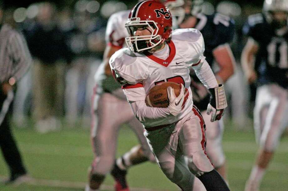 New Canaan wingback Duke Repko cuts back against the grain during his weaving second half touchdown run in second quarter action against Wilton. Repko's score put the Rams of New Canaan up 13-0. Photo: J. Gregory Raymond / Stamford Advocate Freelance