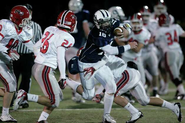 Wilton QB Sean Carroll cuts upfield for yardage during second half FCIAC football action in Wilton. Carroll would later score on a short second quarter run. Photo: J. Gregory Raymond / Stamford Advocate Freelance