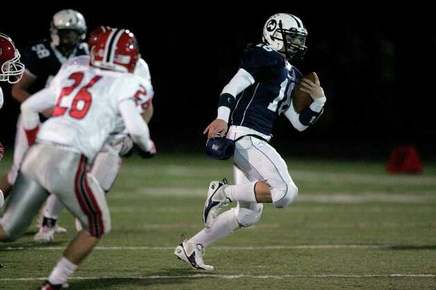Wilton QB Sean Carroll scoots upfield for yardage during second half FCIAC football action in Wilton. Carroll would later score on a short second quarter run to narrow the score against New Canaan, 14-7. Photo: J. Gregory Raymond / Stamford Advocate Freelance