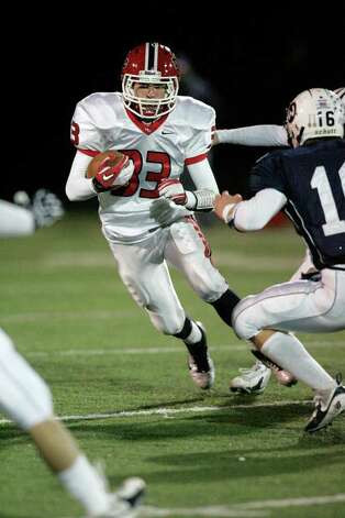 New Canaan RB Louis Hagopian looks upfield for running room during a Friday night FCIAC football battle between New Canaan and Wilton. Photo: J. Gregory Raymond / Stamford Advocate Freelance