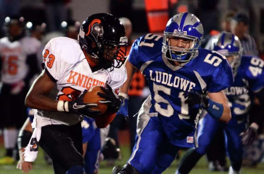 Stamford's Jamor Thompson (23) carries the ball for yardage as Fairfield Ludlowe's Michael Nagy (51) defends during the football game at Taft Field at Ludlowe High School on Friday, Oct. 28, 2011. Photo: Amy Mortensen / Connecticut Post Freelance