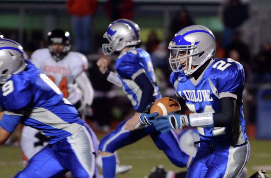 Fairfield Ludowe's Daniel Silvestri (24) returns the ball during the football game against Stamford at Taft Field at Ludlowe High School on Friday, Oct. 28, 2011. Photo: Amy Mortensen / Connecticut Post Freelance