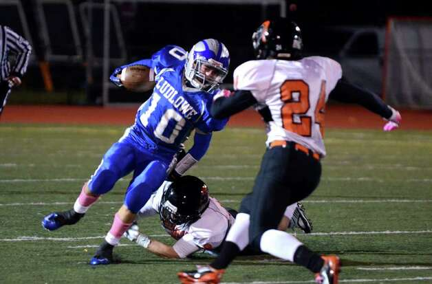 Fairfield Ludlowe's Thomas Howell (10) carries the ball as Stamford's Matt Corcoran (9) defends during the football game at Taft Field at Ludlowe High School on Friday, Oct. 28, 2011. Photo: Amy Mortensen / Connecticut Post Freelance