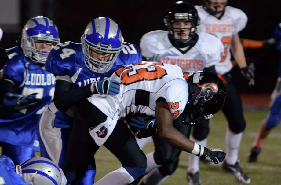Fairfield Ludlowe's Daniel Silvestri (24) brings down Stamford ball carrier Jamor Thompson (23) during the football game at Taft Field at Ludlowe High School on Friday, Oct. 28, 2011. Photo: Amy Mortensen / Connecticut Post Freelance