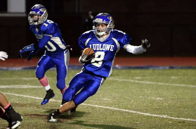 Fairfield Ludlowe's Daniel Santella (8) returns the ball during the football game against Stamford at Taft Field at Ludlowe High School on Friday, Oct. 28, 2011. Photo: Amy Mortensen / Connecticut Post Freelance