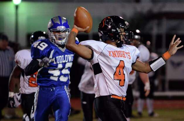 Stamford's Bryan Boderick (4) makes a pass during the football game against Fairfield Ludlowe at Taft Field at Ludlowe High School on Friday, Oct. 28, 2011. Photo: Amy Mortensen / Connecticut Post Freelance