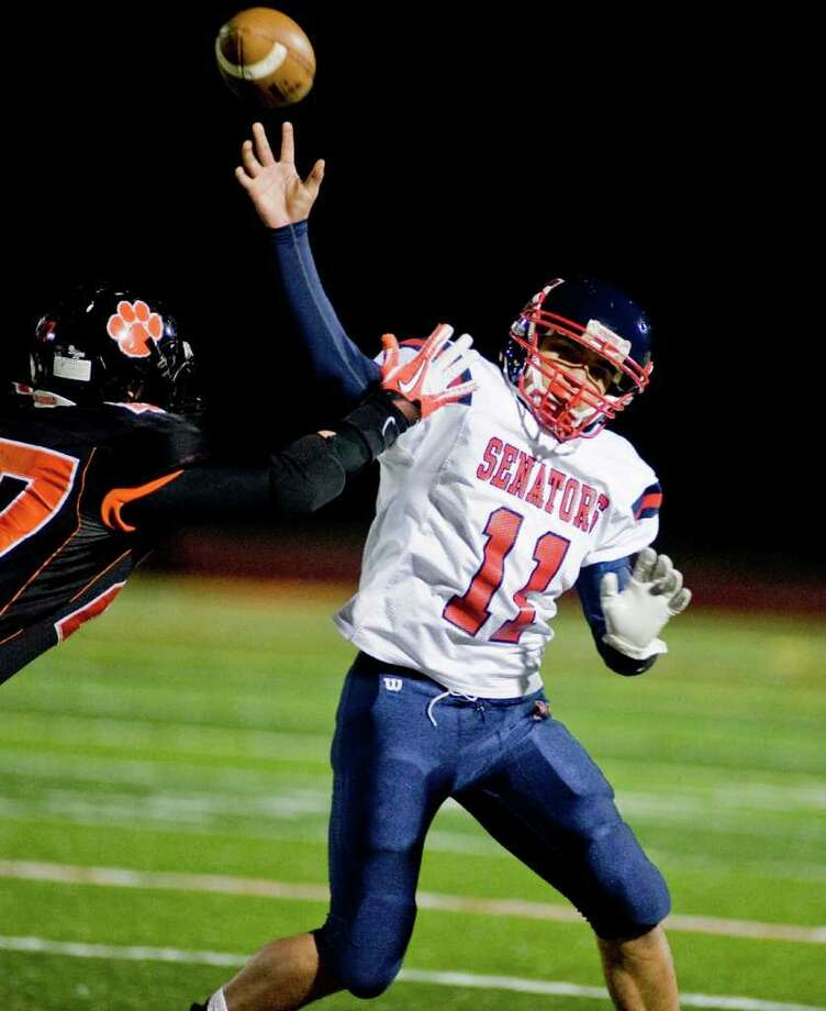 Brien McMahon High School's Damien Vega gets off the pass against Ridgefield High School before being hit during a football game at Ridgefield. Friday, Oct. 28, 2011 Photo: Scott Mullin / The News-Times Freelance