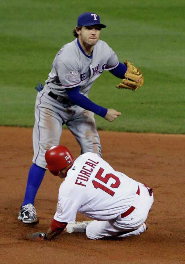 Texas Rangers second baseman Ian Kinsler forces St. Louis Cardinals' Rafael Furcal (15) in Game 7 of the World Series at Busch Stadium in St. Louis, Missouri, on Friday, October 28, 2011. (Ron T. Ennis/Fort Worth Star-Telegram/MCT) Photo: Ron T. Ennis, McClatchy-Tribune News Service / Fort Worth Star-Telegram
