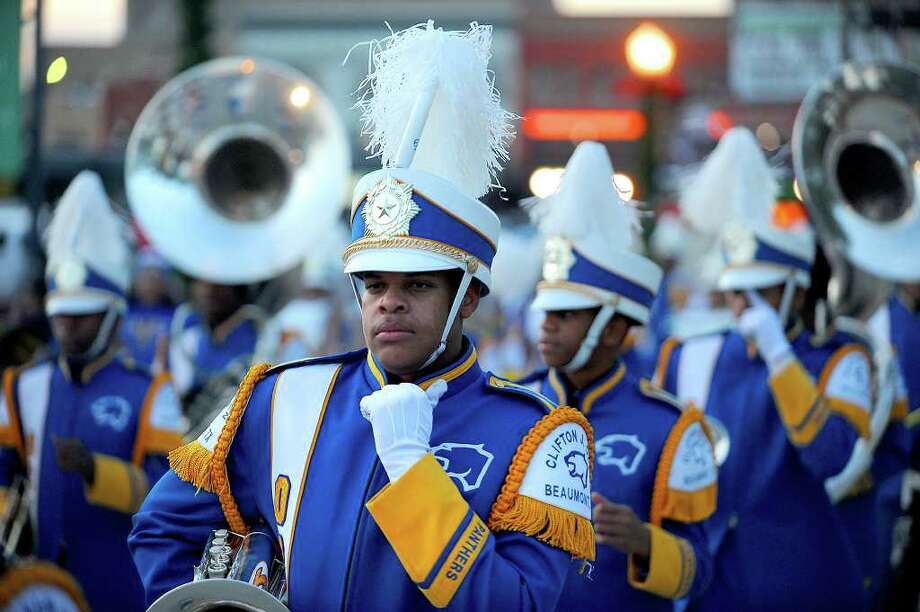 The Ozen High School band leads the way for Beaumont's annual Christmas parade through downtown December, 2009. As a result of increased insurance costs and renovations to Riverfront Park, the City of Beaumont will not hold its annual Christmas Parade this year. Enterprise file photo / Beaumont