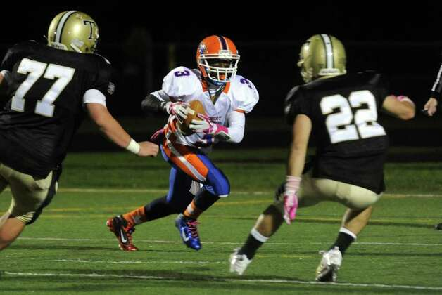 Highlights from boys football action between Trumbull and Danbury in Trumbull, Conn. on Thursday October 28, 2011. Danbury's #3 James Harrington. Photo: Christian Abraham / Connecticut Post