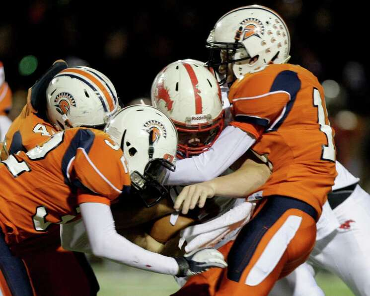 10/28/11: Running back Boomer White #8 of Memorial Mustangs is gang tackled by the  Seven Lakes Spar