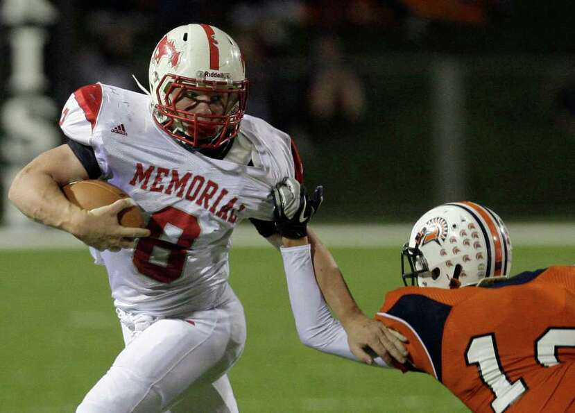 10/28/11: Running back Boomer White #8 of Memorial Mustangs runs over defensive back Ryan Capel #10