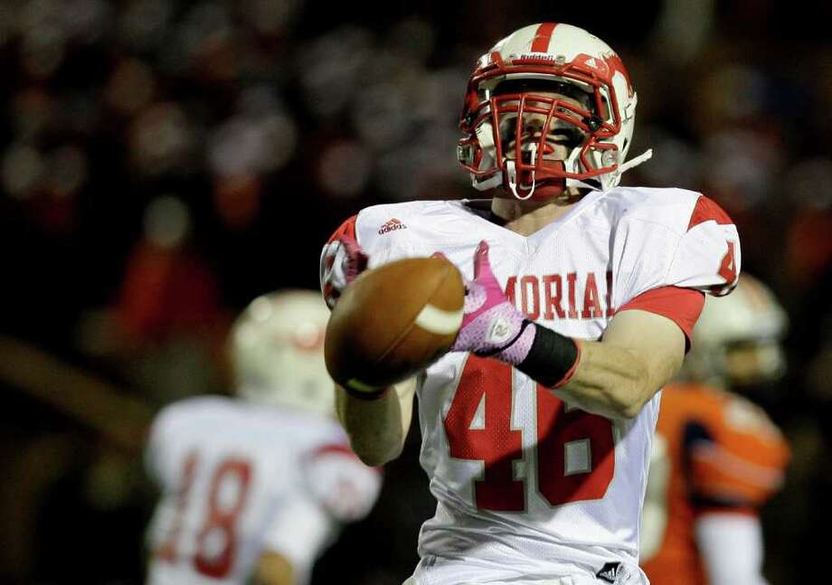 10/28/11: Fullback Brock Davidson #46 of Memorial Mustangs drops the ball in the flat against the Seven Lakes Spartans  in a in district 19-5A high school football game at Rhodes Stadium in Katy, Texas. For the Houston Chronicle: Thomas B. Shea Photo: For The Chronicle: Thomas B. She