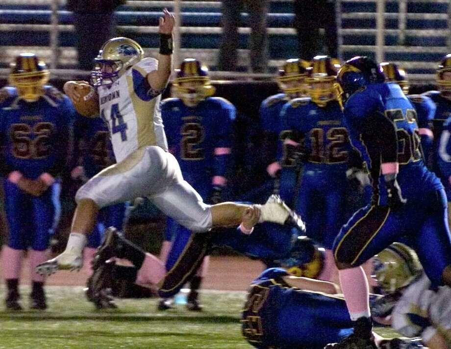 Newtown's Louis Fenaroli runs for a touchdown during their game against Brookfield at Brookfield High School on Friday, Oct. 28, 2011. Newtown won 41-0. Photo: Jason Rearick / The News-Times