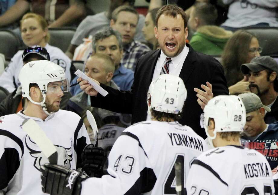 San Antonio Rampage head coach Chuck Weber instructs players during the second period of an AHL hockey game against the Houston Aeros, Friday, Oct. 28, 2011, in San Antonio. Photo: Darren Abate, PRESSPHOTOINTL.COM / Darren Abate/pressphotointl.com