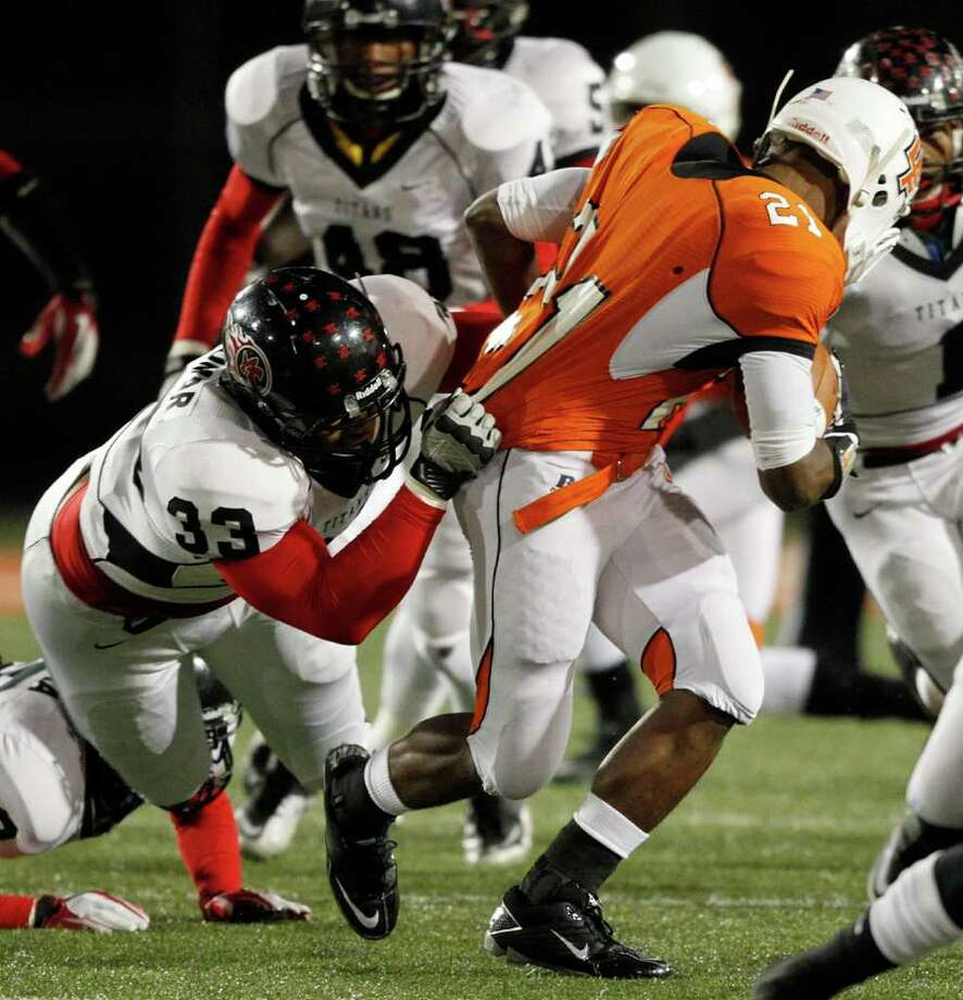 La Porte running back Keith Whitely #21 is tackled by Port Arthur Memorial's Matthew Romar during a high school football game between Port Arthur Memorial and La Porte Friday, October 28 in Laporte, Texas. Photo: Bob Levey, Houston Chronicle / ©2011 Bob Levey