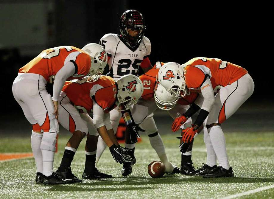 La Porte kicking team downs a punt as PA Memorial's Kenneth Mayfield #25 looks on during a high school football game between Port Arthur Memorial and La Porte Friday, October 28 in Laporte, Texas. Photo: Bob Levey, Houston Chronicle / ©2011 Bob Levey