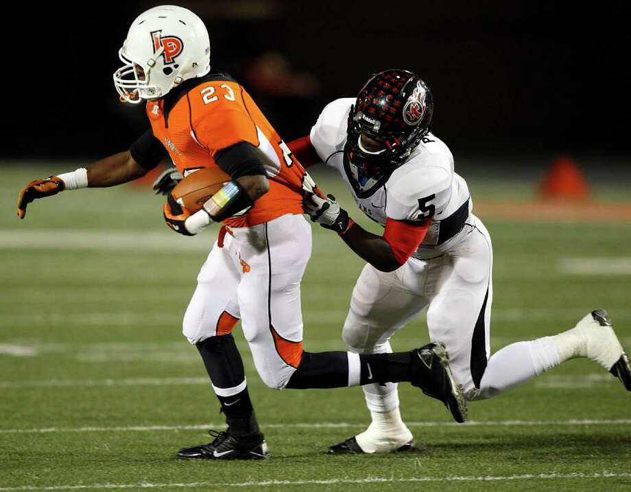 La Porte running back Johnathan Lewis #23 is  brought down by Port Arthur Memorial's Joshua Pickett #5 during a high school football game between Port Arthur Memorial and La Porte Friday, October 28 in Laporte, Texas. Photo: Bob Levey, Houston Chronicle / ©2011 Bob Levey