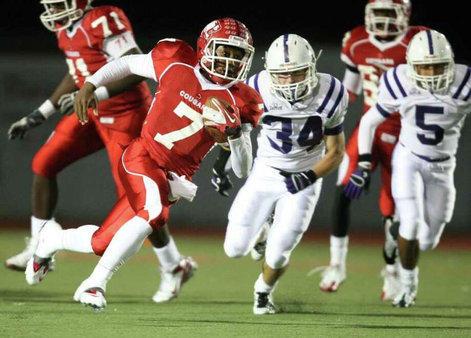 Crosby's Aston Walter (7) runs past Dayton defenders for a 54-yard touchdown during the first half of a District 19-4A high school football game, Friday, October 28, 2011 at Cougar Stadium in Crosby. Photo: Eric Christian Smith, For The Chronicle