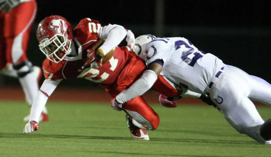 Dayton 31, Crosby 24. Crosby's Austin Walter (left) is tackled by Dayton's Jamaud St. Andre during the first half of a District 19-4A high school football game, Friday, October 28, 2011 at Cougar Stadium in Crosby. Photo: Eric Christian Smith, For The Chronicle