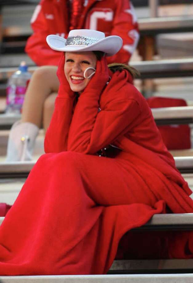 Crosby Cougar Star Makenzee Meaux tries to keep warm before a District 19-4A high school football game against Dayton, Friday, October 28, 2011 at Cougar Stadium in Crosby. Photo: Eric Christian Smith, For The Chronicle
