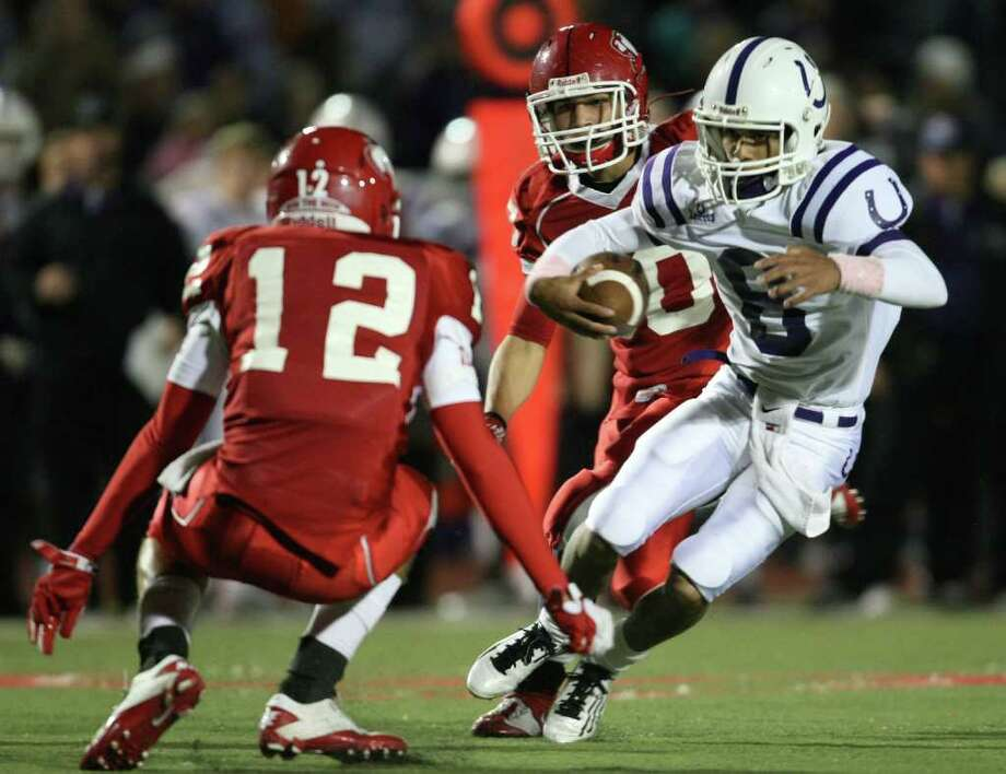 Dayton's Andres Herrera (8) runs past Crosby's Marc Farrish (12) during the first half of a District 19-4A high school football game, Friday, October 28, 2011 at Cougar Stadium in Crosby. Photo: Eric Christian Smith, For The Chronicle