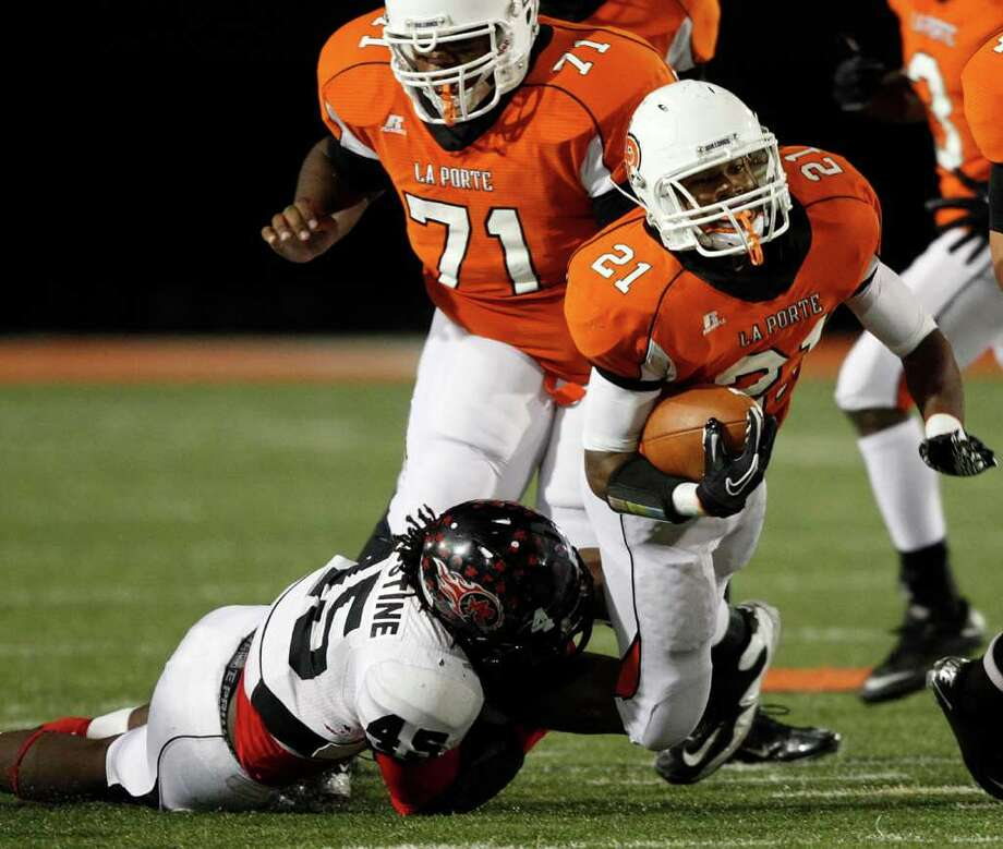 La Porte running Keith Whitely #21 is tripped up by  Port Arthur Memorial's Jereem Augustine #45 during a high school football game between Port Arthur Memorial and La Porte Friday, October 28 in Laporte, Texas. Photo: Bob Levey, Houston Chronicle / ©2011 Bob Levey