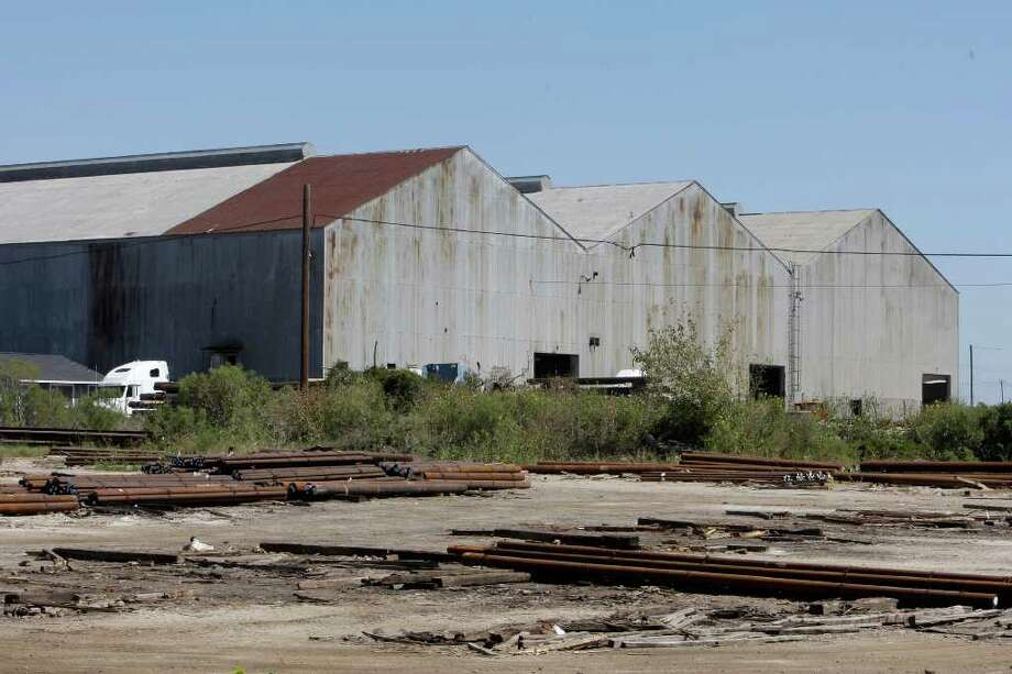 James Nielsen : Chronicle OUT WITH THE OLD: Aging buildings that are no longer in use because cargo has changed are being considered for demolition at the Port of Houston's Turning Basin Terminal. Cotton was once the top freight, but today steel is king. Photo: James Nielsen / © 2011 Houston Chronicle