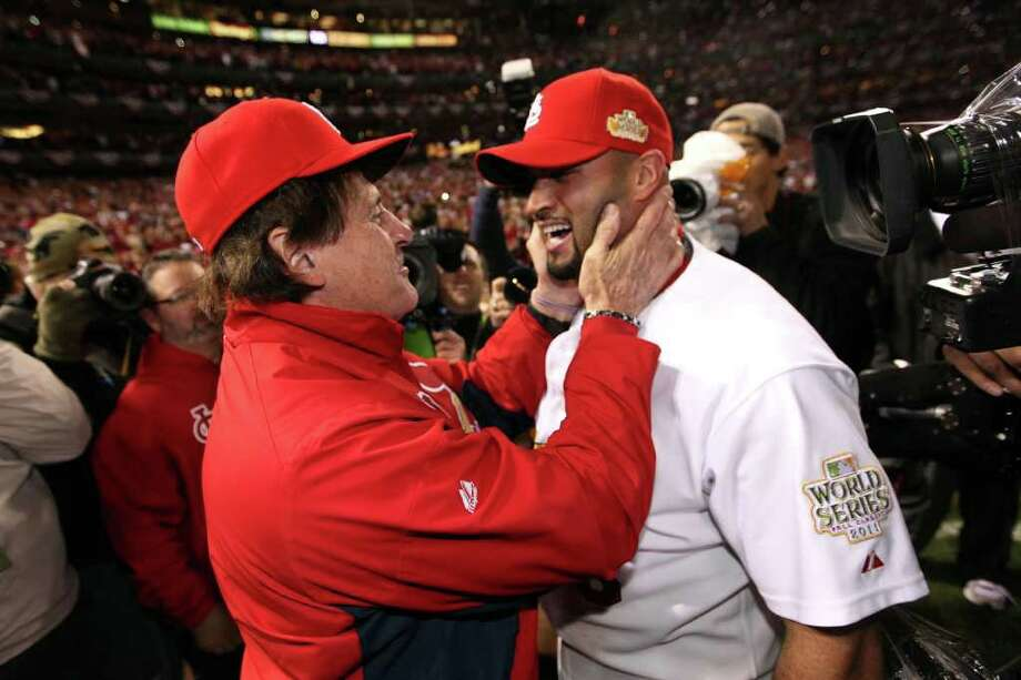 ST LOUIS, MO - OCTOBER 28:  (L-R) Manager Tony La Russa and Albert Pujols #5 of the St. Louis Cardinals celebrate after defeating the Texas Rangers 6-2 to win the World Series in Game Seven of the MLB World Series at Busch Stadium on October 28, 2011 in St Louis, Missouri. Photo: Jamie Squire, Getty / 2011 Getty Images