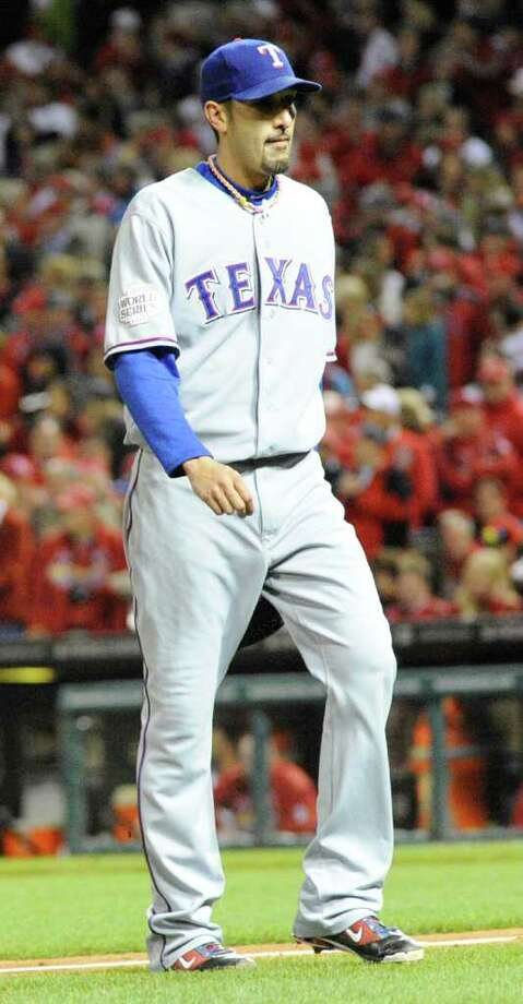 Texas Rangers relief pitcher Mike Adams leaves the game during the seventh inning of a 6-2 loss to the St. Louis Cardinals in Game 7 of the World Series at Busch Stadium in St. Louis, Missouri, on Friday, October 28, 2011. (Max Faulkner/Fort Worth Star-Telegram/MCT) Photo: Max Faulkner, McClatchy-Tribune News Service / Fort Worth Star-Telegram