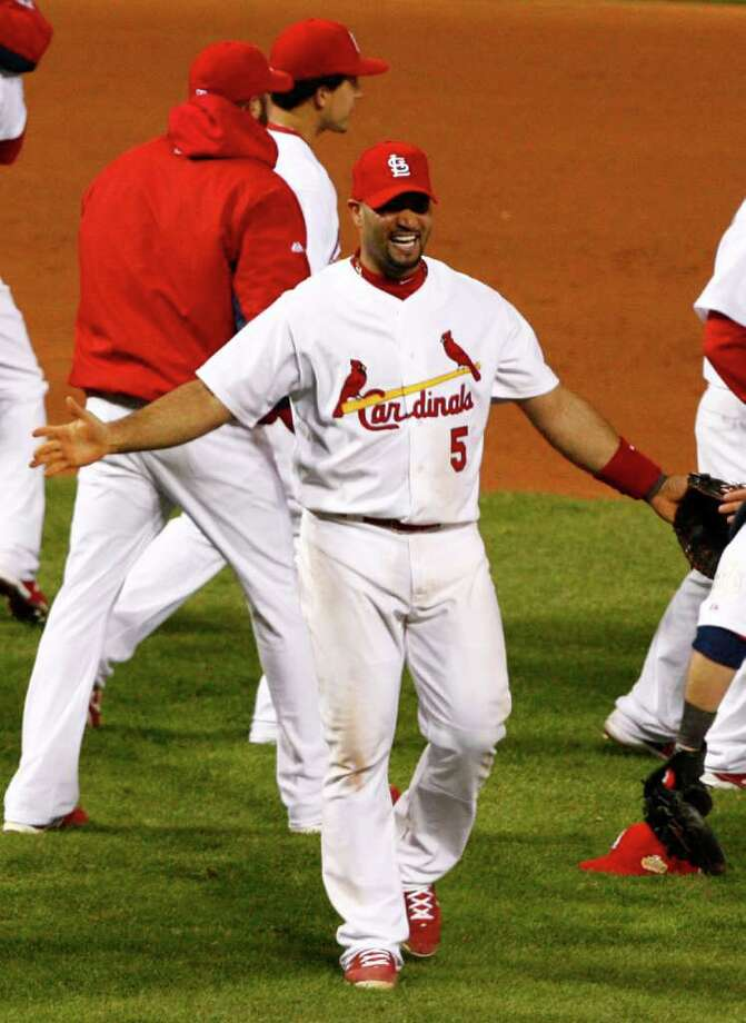 St. Louis Cardinals first baseman Albert Pujols (5) joins the celebration of a 6-2 win over the Texas Rangers in Game 7 of the World Series at Busch Stadium in St. Louis, Missouri, on Friday, October 28, 2011. (Ron T. Ennis/Fort Worth Star-Telegram/MCT) Photo: Ron T. Ennis, McClatchy-Tribune News Service / Fort Worth Star-Telegram
