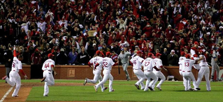St. Louis Cardinals react after beating the Texas Rangers 6-2 at Game 7 of baseball's World Series Friday, Oct. 28, 2011, in St. Louis. The Cardinals win the series 4-3.  (AP Photo/Jeff Roberson) Photo: Jeff Roberson, Associated Press / AP