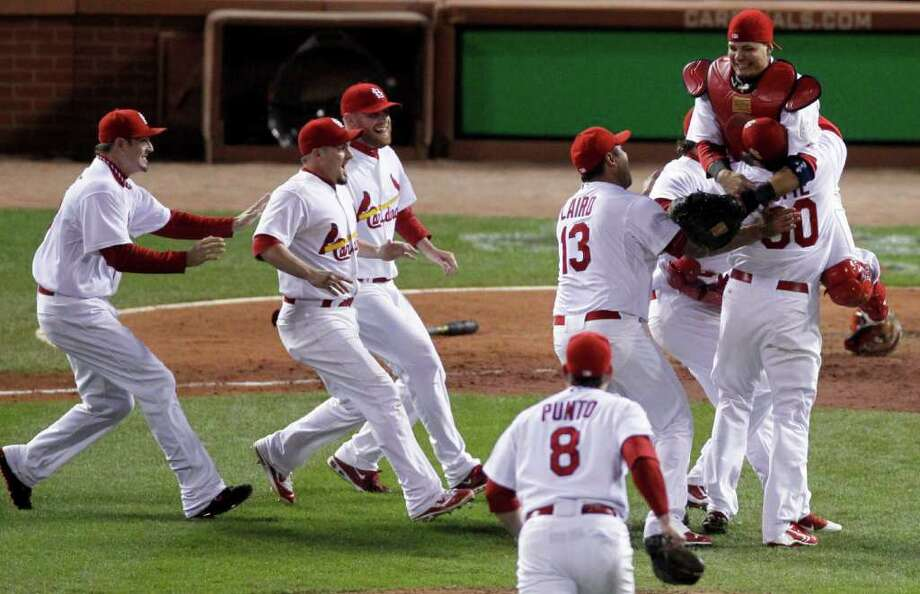 St. Louis Cardinals react after beating the Texas Rangers 6-2 at Game 7 of baseball's World Series Friday, Oct. 28, 2011, in St. Louis.  Photo: Jeff Roberson, Associated Press / AP