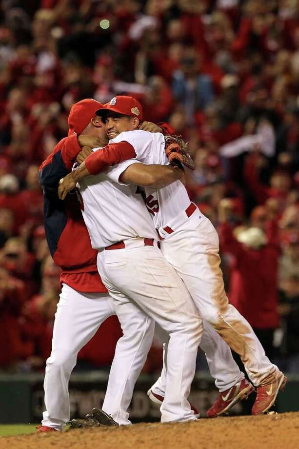 ST LOUIS, MO - OCTOBER 28:  Rafael Furcal #15 and Albert Pujols #5 of the St. Louis Cardinals celebrate after defeating the Texas Rangers 6-2 to win the World Series in Game Seven of the MLB World Series at Busch Stadium on October 28, 2011 in St Louis, Missouri. Photo: Jamie Squire, Getty / 2011 Getty Images