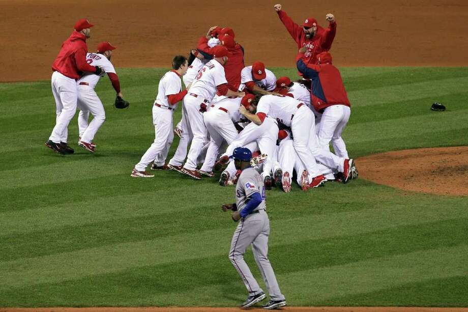 ST LOUIS, MO - OCTOBER 28:  The St. Louis Cardinals celebrate after defeating the Texas Rangers 6-2 to win the World Series in Game Seven of the MLB World Series at Busch Stadium on October 28, 2011 in St Louis, Missouri. Photo: Doug Pensinger, Getty / 2011 Getty Images