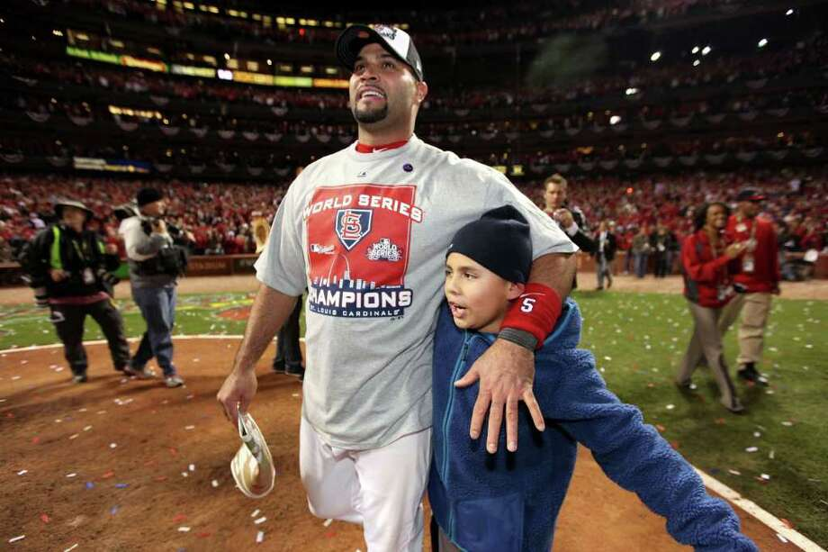 ST LOUIS, MO - OCTOBER 28:  Albert Pujols #5 of the St. Louis Cardinals celebrates with family after defeating the Texas Rangers 6-2 to win the World Series in Game Seven of the MLB World Series at Busch Stadium on October 28, 2011 in St Louis, Missouri. Photo: Jamie Squire, Getty / 2011 Getty Images