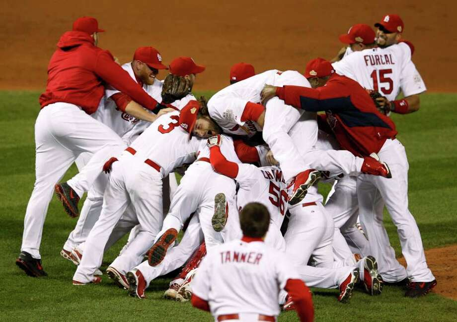 The St. Louis Cardinals celebrate after Texas Rangers' David Murphy hit a fly out to end Game 7 of baseball's World Series Friday, Oct. 28, 2011, in St. Louis. The Cardinals won 6-2 to win the series. (AP Photo/Eric Gay) Photo: Eric Gay, Associated Press / Copyright 2011 The Associated Press. All rights reserved. This material may not be published, broadcast, rewritten or redistribu